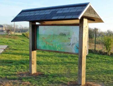 Réimplantation du panneau d'affichage à l'entrée du Bois